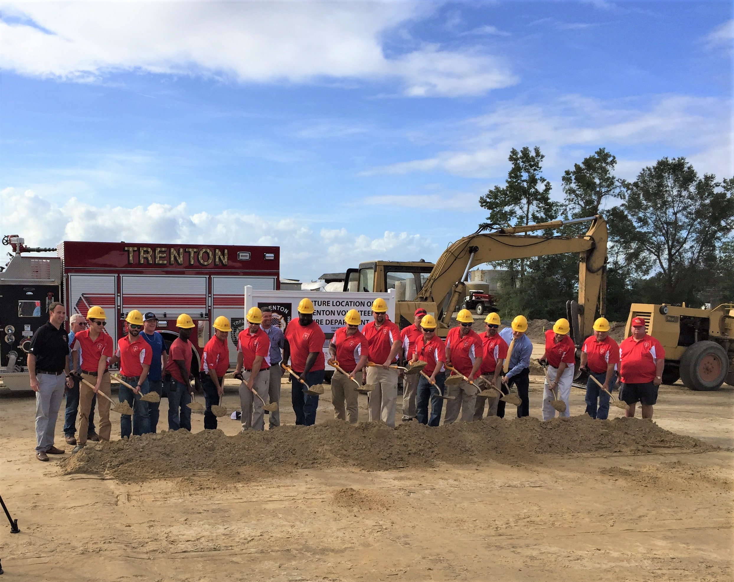 Volunteer Trenton Firemen with shovels and hard hats performing a groundbreaking ceremony